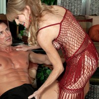Over Fifty MILF Denise Day letting monster-sized juggs free from lingerie for nipple munching