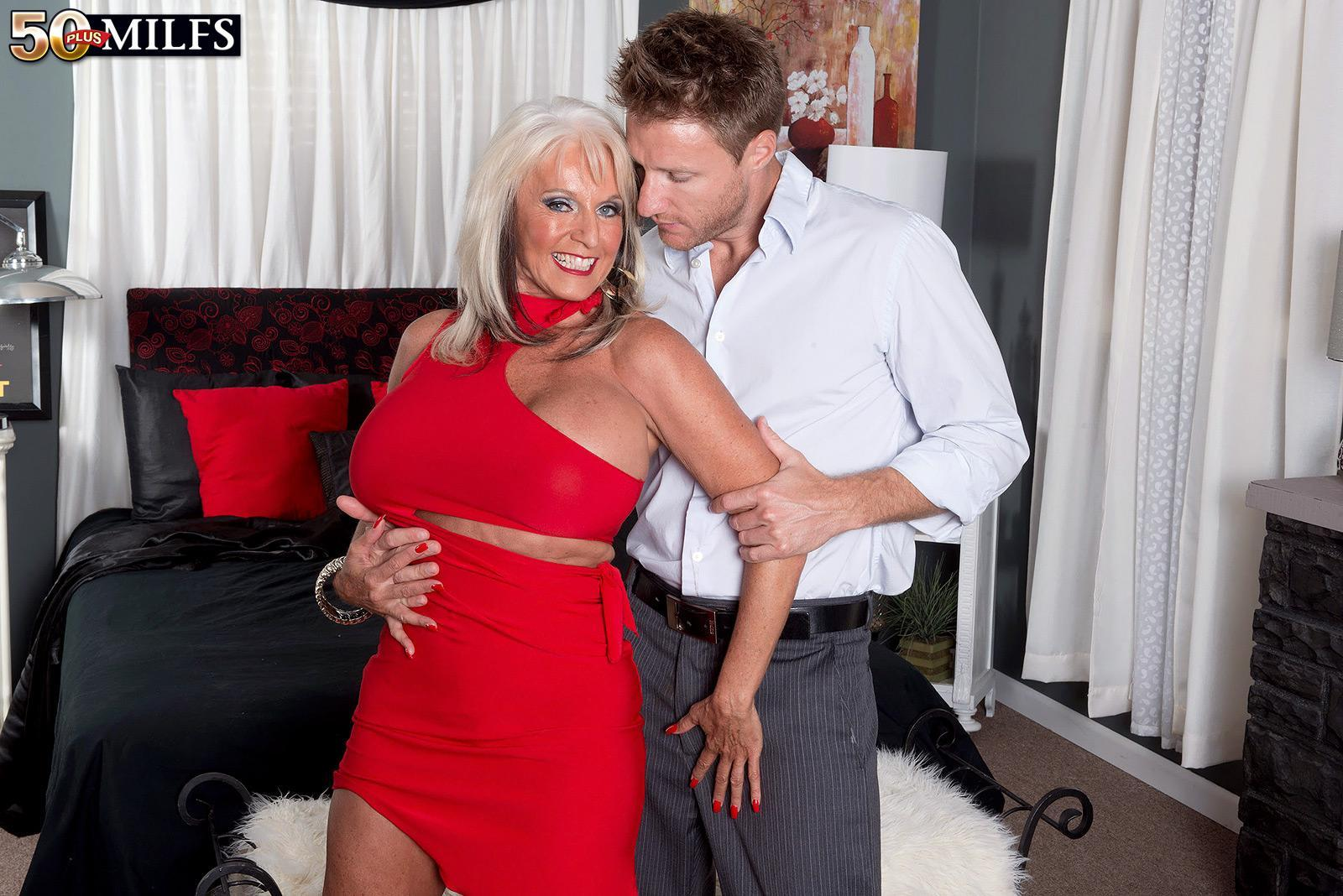 Over 50 MILF Sally D'Angelo having enormous juggs liberated from dress by junior guy