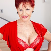Over 60 redhead Caroline Hamsel plays with her boobs garmented crotchless panties