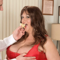 Over weight chick Jennifer slurps a plate of sweets while taking a jizz shot on her hefty boobs