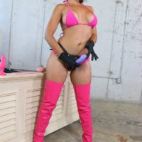 Small and big-titted bitch Kylie Rogue flaunting huge strap on cock in stripper boots