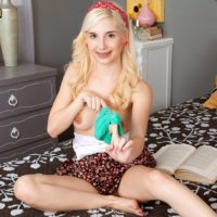 Tiny golden-haired teenage Piper Perri flashes her undies before loosing her little boobs
