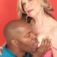 Smallish grannie Miranda Torri has her nipples fellated by her junior black paramour