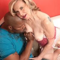 Smallish grannie Miranda Torri has her nipples fellated by her junior black paramour