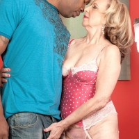 Small grandmother Miranda Torri has her erect nipples sucked by her junior ebony paramour