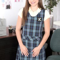 Small schoolgirl Kharlie Stone is disrobed naked by her principal in his work environment place