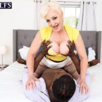 Platinum golden-haired granny Seka black deepthroats off a junior man's massive black penis