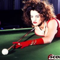 X-rated actress Nilli Willis unsheathes her humungous tits on pool table in crimson gloves and dress