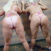 Pornstars Kayla Kleevage and Claudia Marie share a lezzy kiss after modeling bathing suits