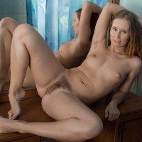 Ginger-haired first timer Nikky B touts her elastic bootie before spreading her smooth-shaven muff