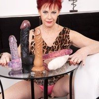 Redhead grandmother Caroline Hamsel gobbles and deepthroats her collection of sex toys in underwear