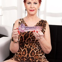 Red-haired grandmother Caroline Hamsel licks and bj's her bevy of sex toys in underwear