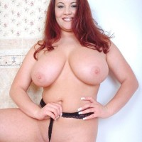 Redhead MILF Annie Swanson wets her gigantic tits in the bathtub during solo act
