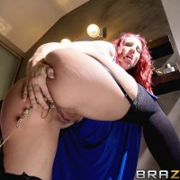 Redhead MILF pornstar Kelly Divine bum penetrated by large dick in ebony stockings