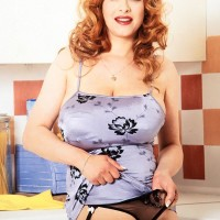 Redhead MILF Ruth Tyler holds her big funbags while showing her wooly coochie