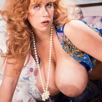 Red-haired MILF Tabatha Towers releases her enormous hooters in over the knee pantyhose