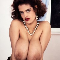 Redhead model Nilli Willis puts her monster-sized melons on demonstrate in mind-blowing nylon socks