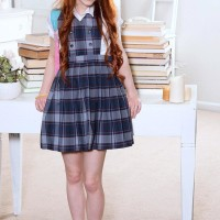 Red-haired teener Dolly Small uncovering smallish funbags and taut ass from under school uniform