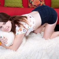 Redhead nubile Jennifer Matthews strips naked on her bed to feast turning Legal
