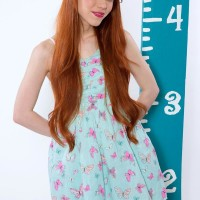 Redheaded teener X-rated actress Dolly Little unsheathing diminutive funbags in super-cute underwear