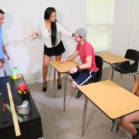 Sex education instructor Jamie Valentine abjecting her students with a monster-sized sex toy