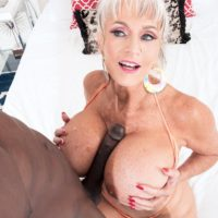 Sex grandmother Sally D'Angelo and her immense titties take on a big ebony penis outdoors in a Jacuzzi