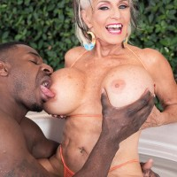 Sex grandmother Sally D'Angelo and her hefty melons take on a BIG EBONY COCK outdoors in a Jacuzzi