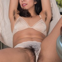 Sexy first-timer Vivi Marie showcases off her fur covered pits and utter thicket out on the balcony