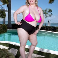 Wondrous BIG BEAUTIFUL WOMAN Laddie Lynn bares her humungous all-natural boobies from a swimsuit top out by the pool