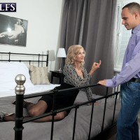Beguiling sandy-haired granny Beata tempts a junior stud in a black mini-skirt and nylons
