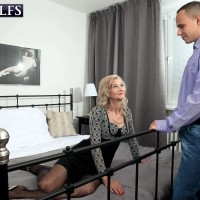 Sweet platinum-blonde grannie Beata seduces a younger man in a ebony microskirt and tights