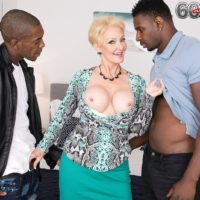 Foxy yellow-haired grannie Seka black fellates on a duo of big black pricks during MMF sex