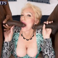 Tempting fair-haired grandmother Seka black deepthroats on a duo of monster-sized ebony peckers during MMF sex