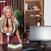 Magnificent platinum-blonde coed Katie Thornton pinches her hard nips after unleashing her gigantic breasts