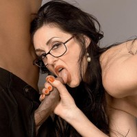 Jaw-dropping brown-haired grandmother Lake Russell seduces a blows a younger ebony man on a couch