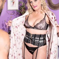 Sexy aged golden-haired Doll Dulbin seduces a junior stud in a enticing lingerie ensemble