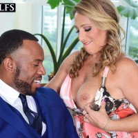 Tempting aged lady Torri Lee entices a ebony man by loosing her big breasts from her dress