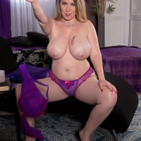 Tempting MILF Desiree sets her large titties loose of a mauve dress and melon-holder in solo action