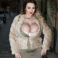 Tempting MILF Micky Bells sets her hefty tits free off a tight fitting dress during solo act