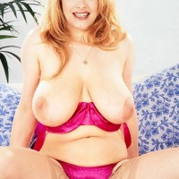 Hot MILF Ruth Tyler puts her gigantic breasts on show in see-through pantyhose and high-heels