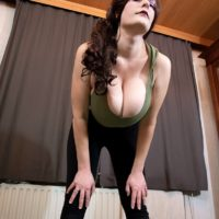 Beguiling redhead stunner Cleo lets out her massive tits during a yoga routine