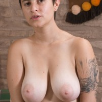 Short haired first-timer female Sue unsheathing massive natural boobs and furry muff