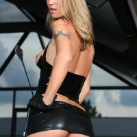 Solo girl Alina Long displays her petite tits in spandex clothing and thigh high boots