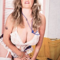Solo girl Cathy Patrick frees her humungous tits in milky hose and garters