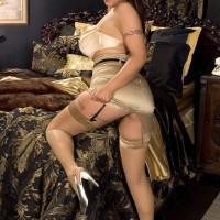 Solo female Eva Notty removes a taut miniskirt to model fully-clothed in lingerie and nylons
