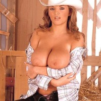 Babe Ines Cudna letting immense boobs free in denim jeans and cowgirl hat in barn