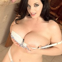 Solo female Joana Bliss sets her humungous breasts free of a bra in her panties