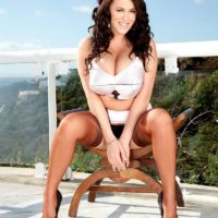 Stunner Leanne Crow lets out her increased breasts on a balcony in tan tights