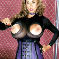 Babe Minka shows off her enormous titties in a cupless bodysuit and a waistline cincher