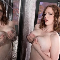 Solo girl model Bebe Cooper pulling out large stringing up boobies from sexy lingerie in hosiery